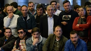 Supporters of the opposition People's Republican Party (CHP) anxiously watch the polling results in Ankara, Turkey