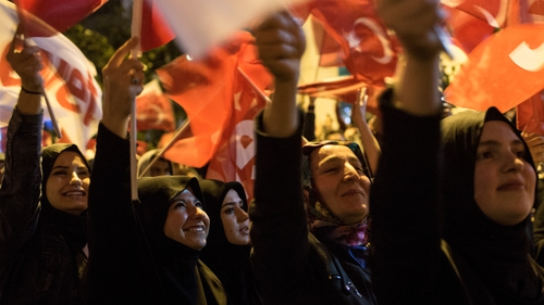 Supporters of Turkish President Erdogan celebrate as the results of the constitutional referendum are announced in Istanbul