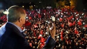 Recep Tayyip Erdogan waves to supporters during a rally in front of the residence in Istanbul, Turkey, yesterday