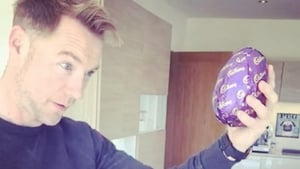 Ronan Keating bashes open his Easter egg with his head, image via Instagram