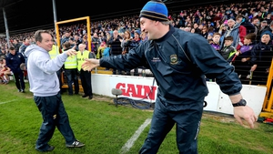 Davy Fitzgerald (L) and Michael Ryan shake hands after Tipp's defeat of Wexford