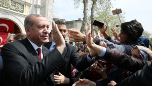 Recep Tayyip Erdogan greets people today after praying at Eyup Sultan mosque in Istanbul