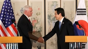 South Korea's Acting President Hwang Kyo-ahn (R) and Mike Pence hold a joint news conference on the allies' robust alliance against North Korea's military provocations in Seoul, South Korea