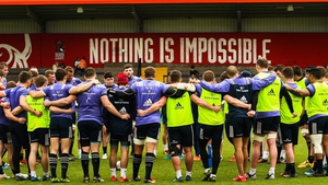 Munster players huddle together after training