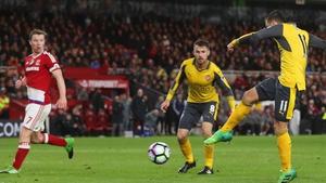 Mesut Ozil fires home the Arsenal winner