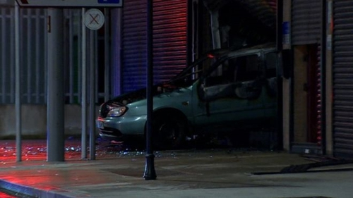 A car was reversed through the shutters of the business