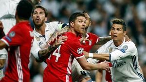 Sergio Ramos, Xabi Alonso and Cristiano Ronaldo prepare for a cross at the Bernabeu