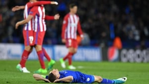 A dejected Jamie Vardy lays on the pitch following the defeat to Atletico Madrid