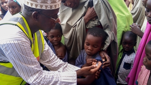 A doctor vaccinates a child against meningitis in Dakwa village, Bwari, Nigeria