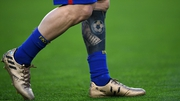 The tattooed left leg of Leo Messi - who struck his 100th goal in European football last night