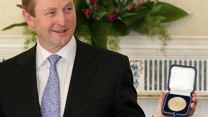 Enda Kenny poses with his new seal of office at Áras an Uachtaráin on 9 March 2011