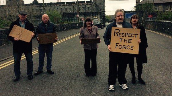 Spouses and former Defence Force workers protest on behalf of current members at Renmore Barracks in Galway