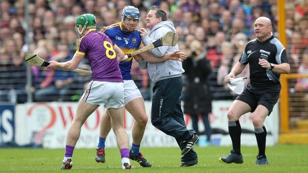 Jason Forde tangles with Davy Fitzgerald at Nowlan Park