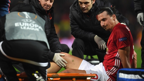 Ibrahimovic lays on the Old Trafford turf after hurting his leg at the end of normal time.