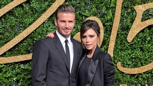 Victoria Beckham receives OBE award from Prince William