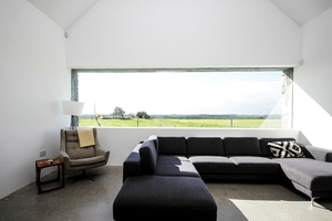 High ceiling and enormous picture windows made this farmhouse a winner.