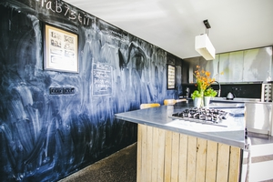 The kitchen had personalised touches such as this chalkboard wall.