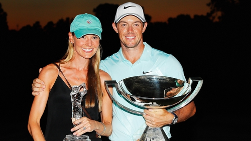 Rory McIlroy poses alongside his fiancé Erica Stoll and the FedExCup and TOUR Championship trophies after his victory