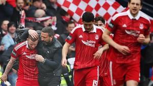 Aberdeen manager Derek McInnes congratulates Jonny Hayes