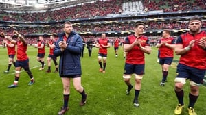 Munster players salute the fans