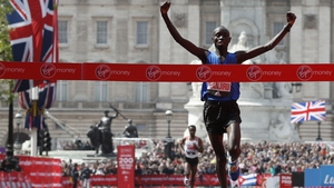 Daniel Wanjiru crosses the line ahead of Bekele