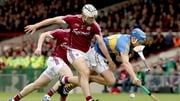 Galway's Daithi Burke with John McGrath of Tipp