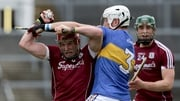 Galway's Conor Whelan with James Barry of Tipperary