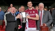 Galway captain David Burke (C) with President Michael D Higgins (L) and GAA President Aogan O'Fearghail