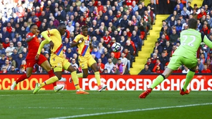 Christian Benteke scores the first of his two goals at Anfield