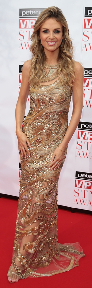 VIP's Most Stylish Newcomer, Ruth O'Neill wore a golden gown from Theia Couture dress.