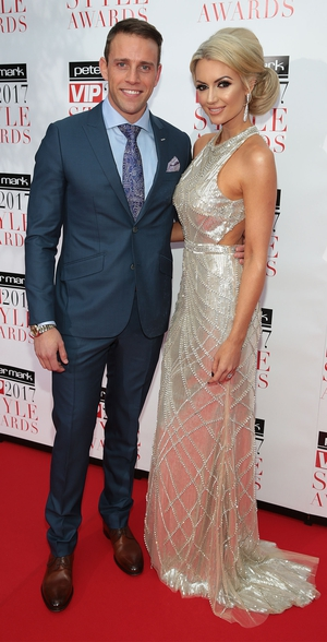 Nutritional Therapist Rosanna Davison, pictured with hubby Wes Quirke, wore a silver gown from Cari's Closet.