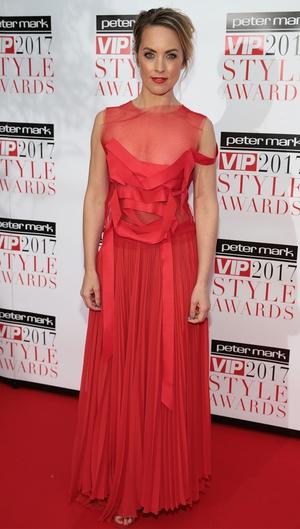 Fitness guru Kathryn Thomas wore a floor length red dress from Helen Cody Dublin.