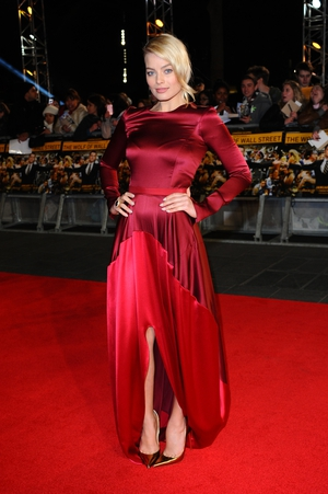 Lady in red! Margot shines in an Oscar de la Renta dress at the UK Premiere of The Wolf of Wall Street in 2014. These shoes seem to be made of gold!
