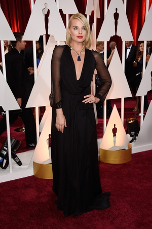 The actress looked simply stunning at the 2015 Oscars ceremony in this Saint Laurent gown. We love her haircut and necklace!