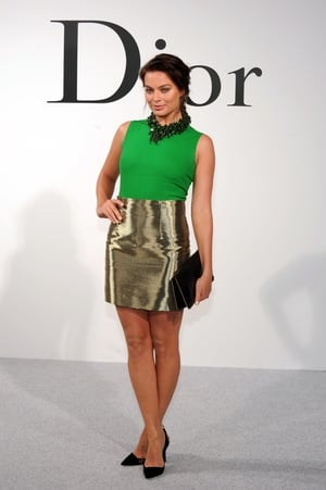The Aussie actress wearing a very creative and chic combo at the Christian Dior Cruise 2015 Show in 2014.
