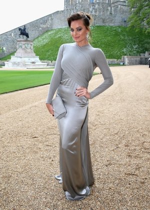 Looking like a real Lady at an event celebrating The Royal Marsden hosted by the Duke of Cambridge in 2014. This draped Ralph Lauren gown is dreamy.