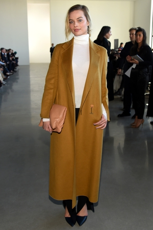 Wearing Calvin Klein for the the Calvin Klein New York Fashion Week show in 2016. She's rocking a polo neck and coat like no one else!