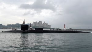 A handout photo made available by the United States Department of Defense shows the Ohio-class guided-missile submarine USS Michigan arriving in Busan, South Korea