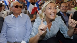 Jean-Marie and Marine Le Pen at a National Front event in 2014