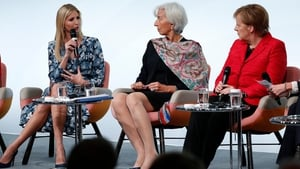 Christine Lagarde (C) and Angela Merkel (R) listen as Ivanka Trump addresses the summit