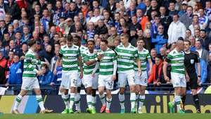 Callum McGregor (C) is mobbed after netting Celtic's first