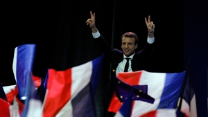 Emmanuel Macron gave a 15-minute speech on Sunday night and held his arms aloft in a V for victory