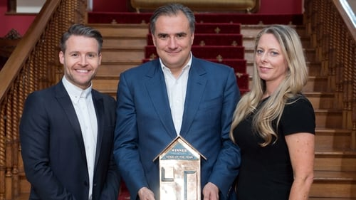 The winners of Home of the Year: Louise McGuane & Dominic McCarthy with their trophy next to judge Declan O'Donnell.