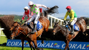 Sizing John (r) jumps the last behind Djakadam in the 2017 Punchestown Gold Cup
