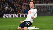 Christian Eriksen slides to celebrate his superb winner