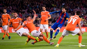 Lionel Messi scores his second - and Barca's fourth - in a seven-goal hammering of Osasuna