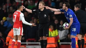 Sanchez and Christian Fuchs protest to the officials