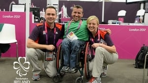 John Fulham, pictured with two volunteers at the London Olympics