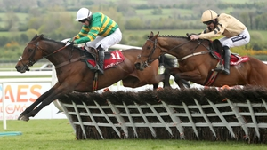 Unowhatimeanharry leads Nichols Canyon over the last at Punchestown