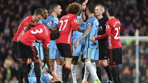 Marouane Fellaini is dismissed by referee Martin Atkinson